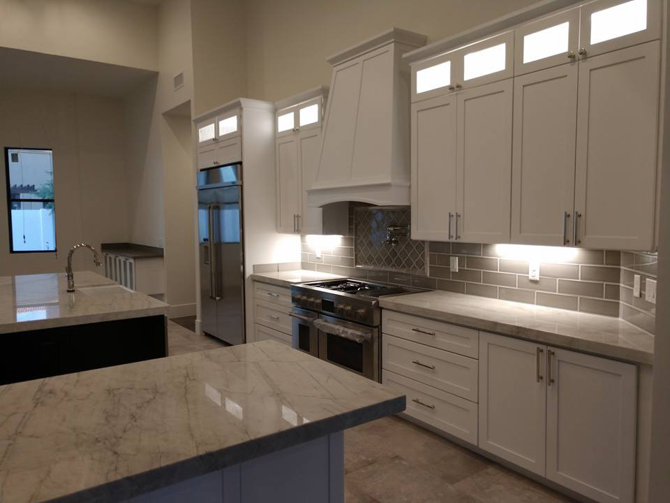 White Kitchen Counter and Light Cabinets