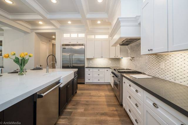 White Shaker Cabinets and Grey Quartz Countertop
